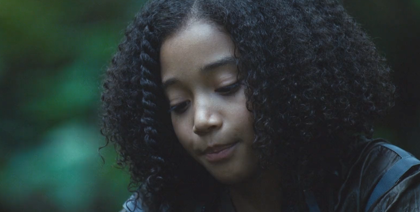Amandla Stenberg as Rue in the hungergames curly hair