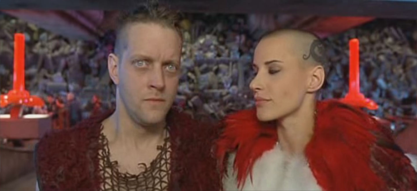 Eve Salvail shaved head hairstyle in fifth element movie dragon tattoo