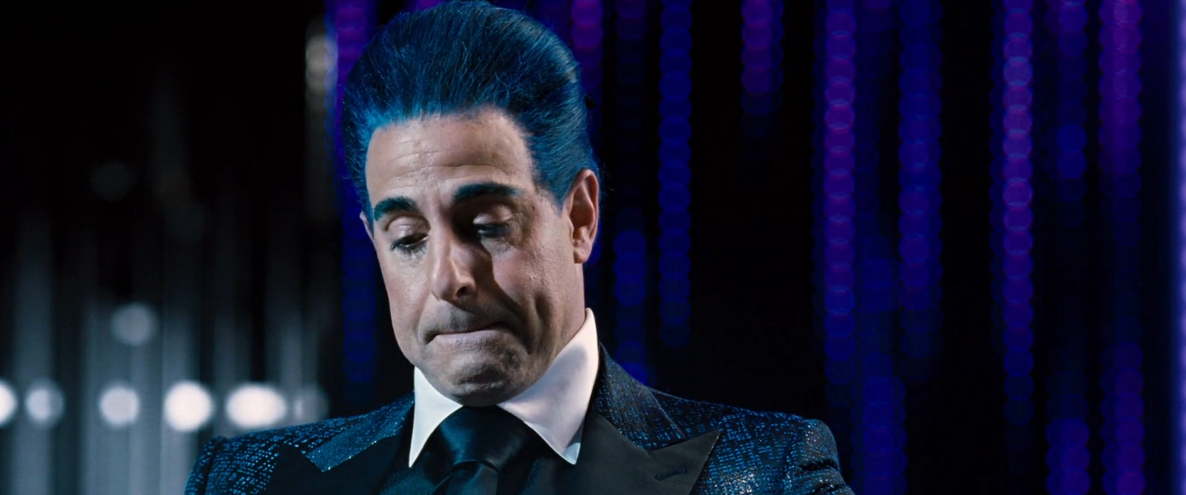 Stanley Tucci in the hunger games with awesome blue hair