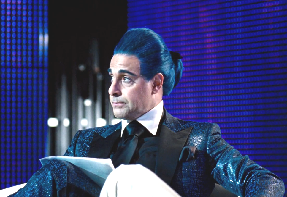 Stanley Tucci playing Caesar Flickerman in the hunger games with awesome blue hair