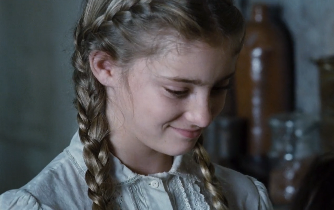 Willow Shields playing Primrose Everdeen dual braid hairstyle