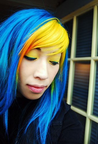 bright yellow and blue hair creates a great contrast making each color look brighter