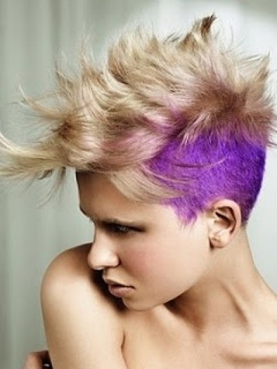 Half shaved fauxhawk hairstyle with blond and purple colouring