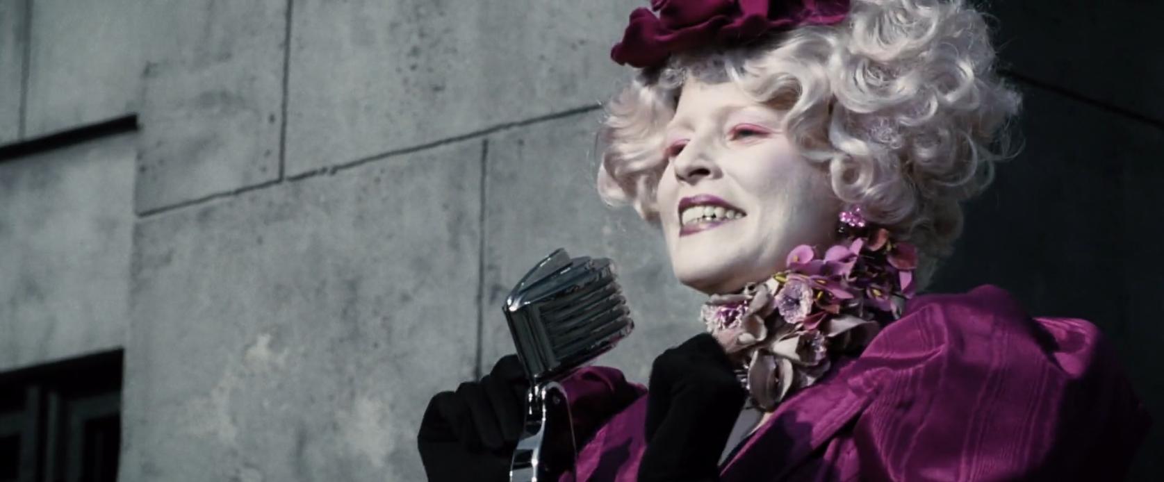 Elizabeth Banks as Effie Trinket in the hunger games fun hair