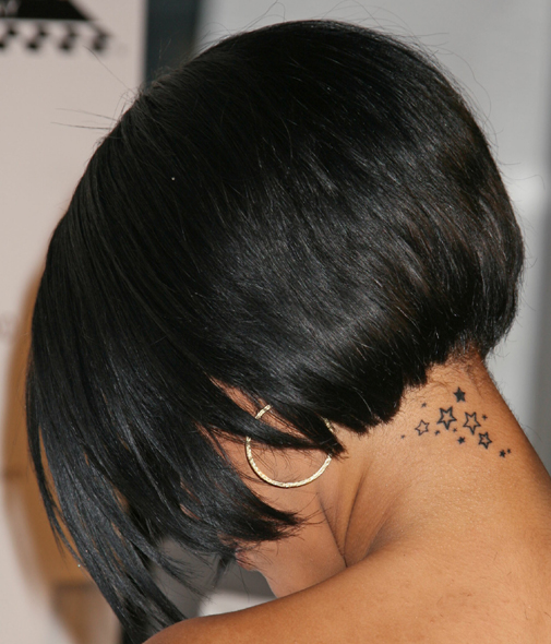 Rihanna hairstyle  and neck tattoo