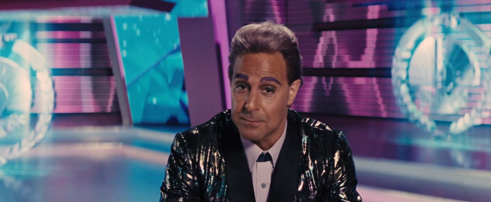 Stanley Tucci purple hair and eyebrows hunger games 2 catching fire