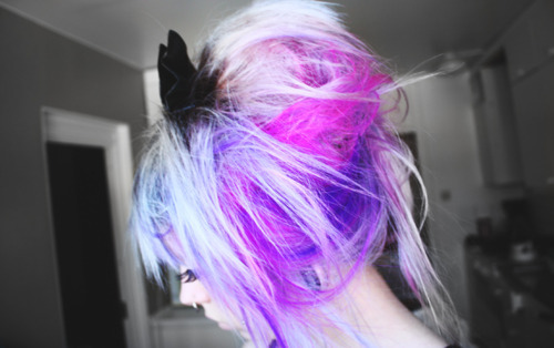 pink purple and blonde super colorful up hairstyle with a bow